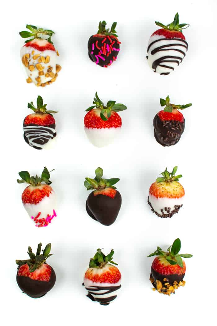 an assortment of chocolate covered strawberries arranged in a grid on a white background