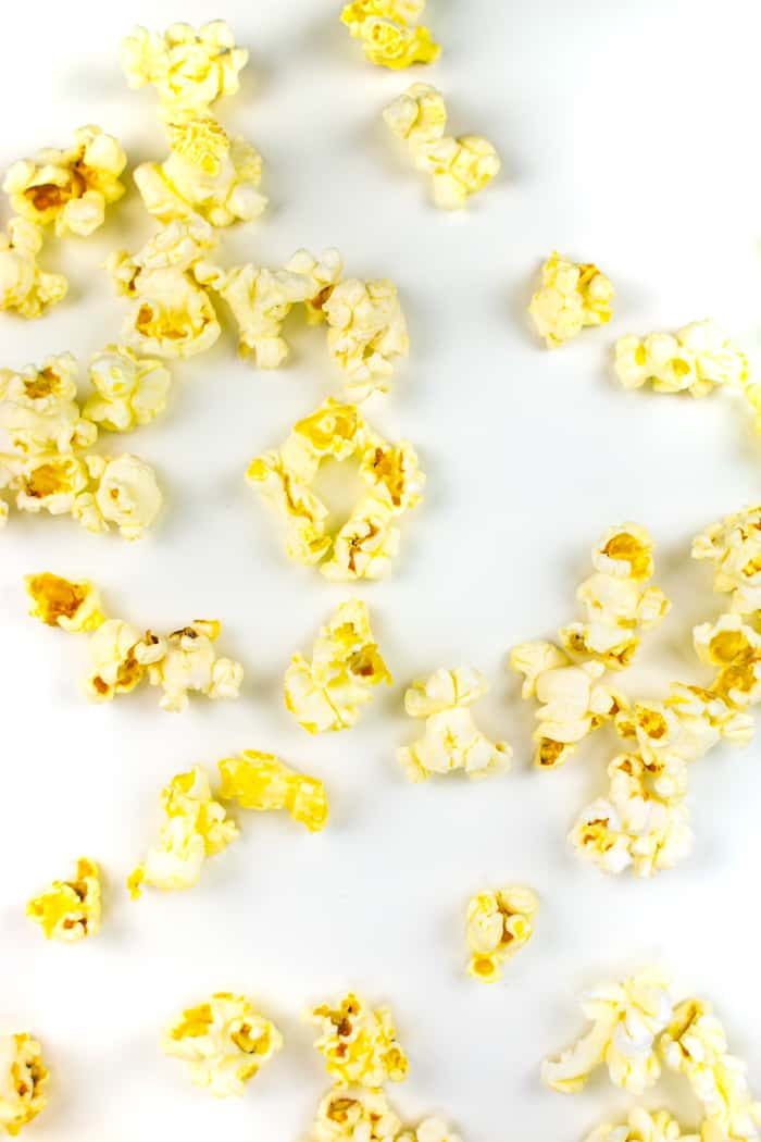 kernels of movie theatre butter on a white background