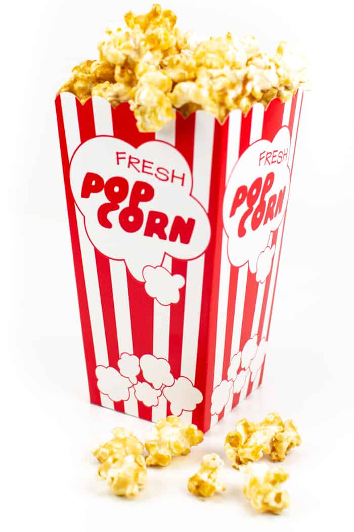 a red and white popcorn container filled with a caramel popcorn recipe