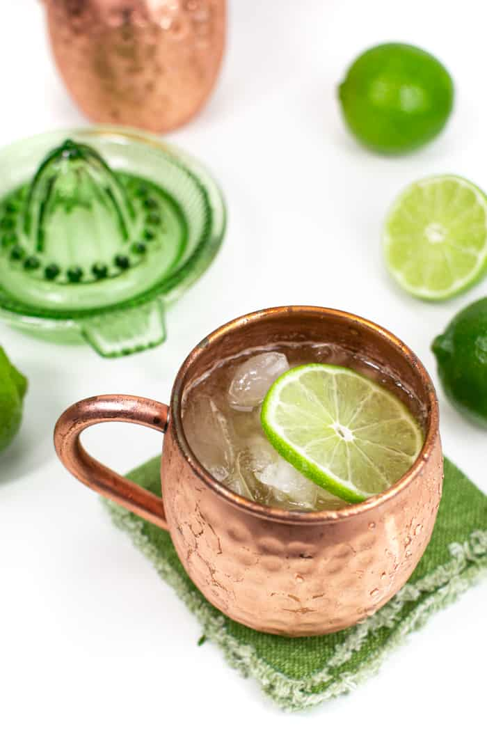picture of Irish mules on green napkins and a green citrus juicer