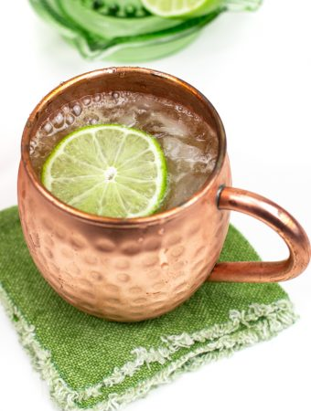 Irish mule recipe in a mule mug on a green cloth napkin