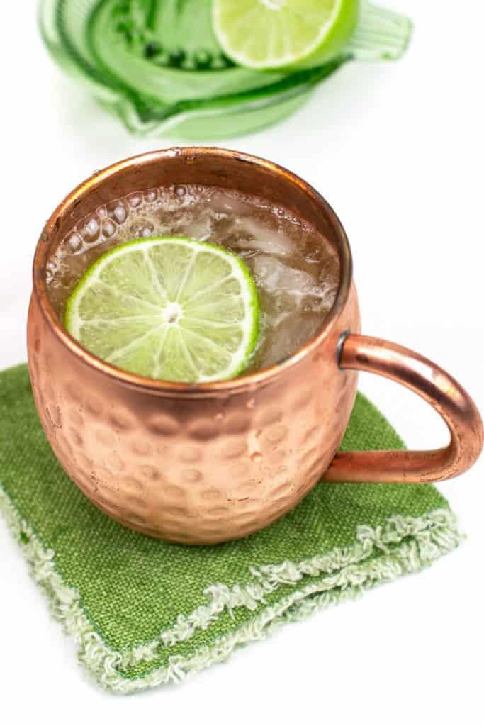 Irish mule recipe in a mule mug on a green cloth napkin