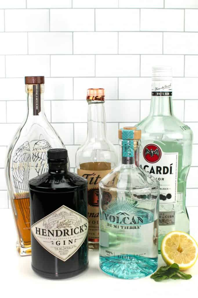 bottles of whiskey, vodka, rum, gin and tequila