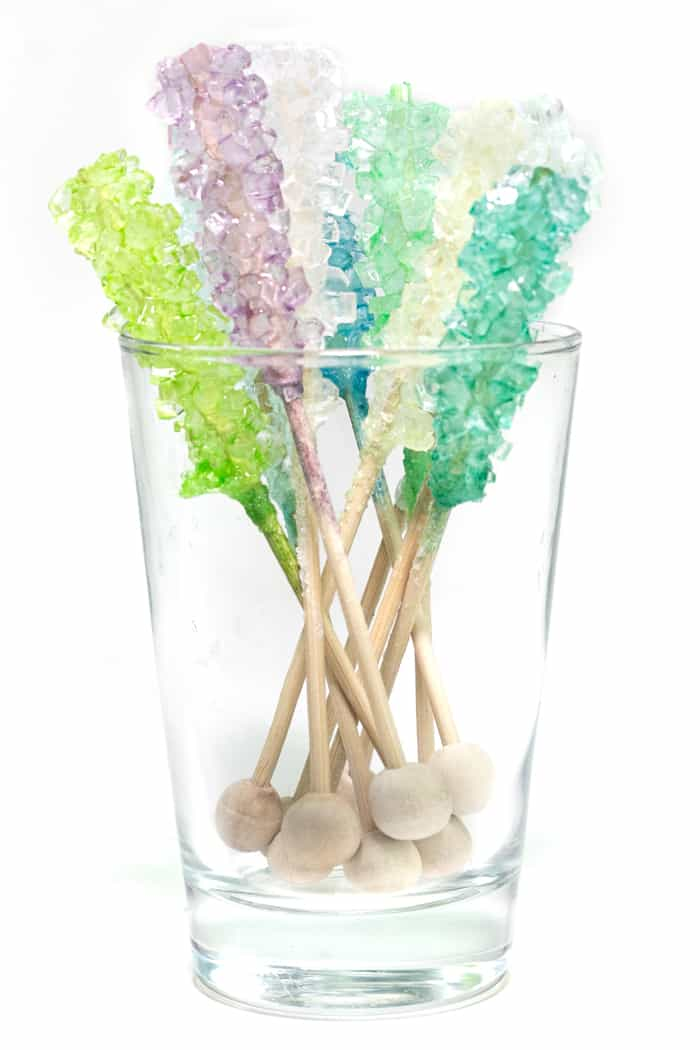 colorful rock candy swizzle sticks in a glass