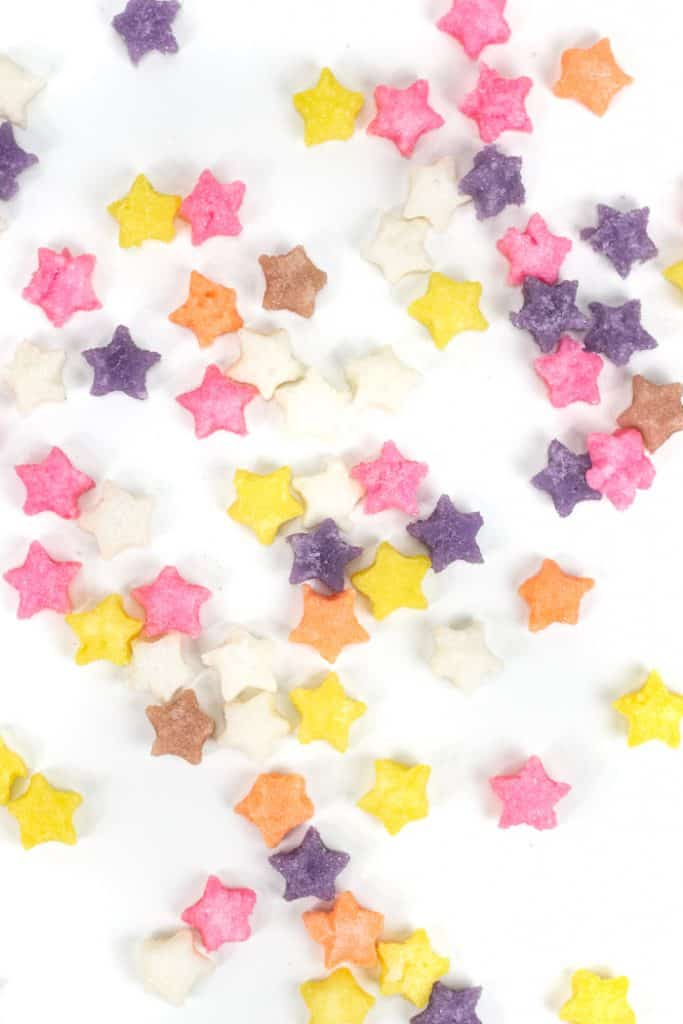 colored sugar cubes arranged on a white background