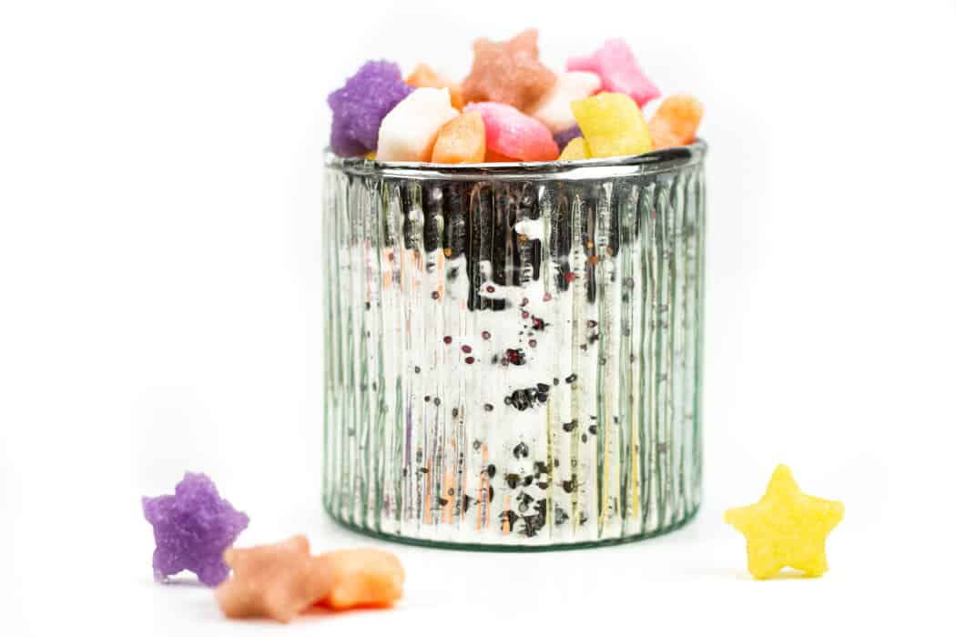 colored sugar cubes in a silver cup