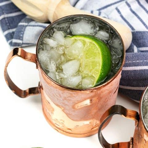 kentucky mule in a copper mule mug with a citrus reamer