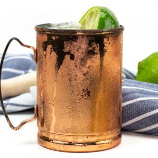 kentucky mule in a copper mule mug with a muddler