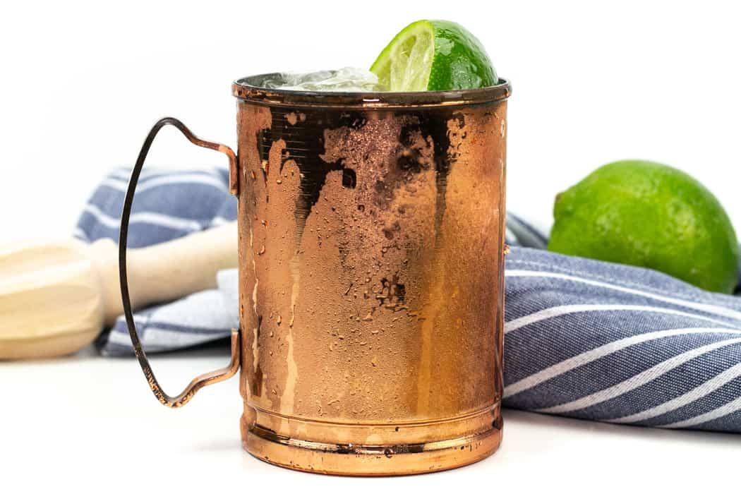 kentucky mule in a copper mule mug with a muddler