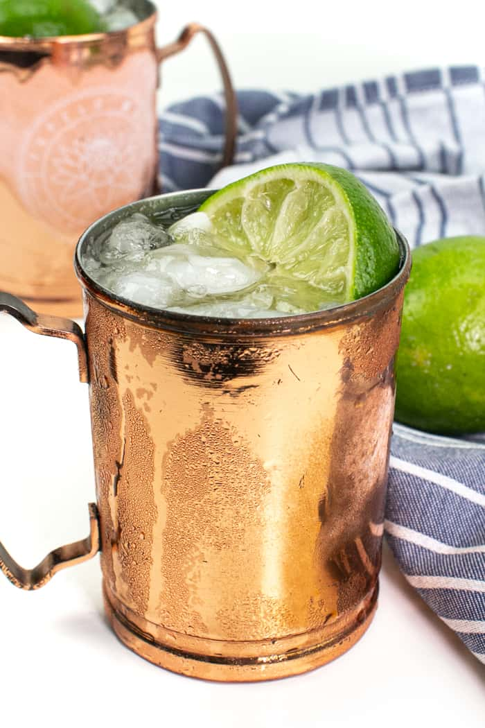 kentucky mule in a copper mule mug with limes