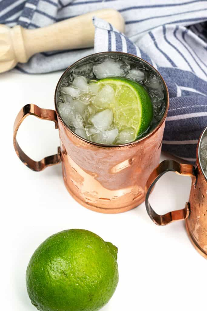 kentucky mule in a copper mule mug with limes and ginger beer