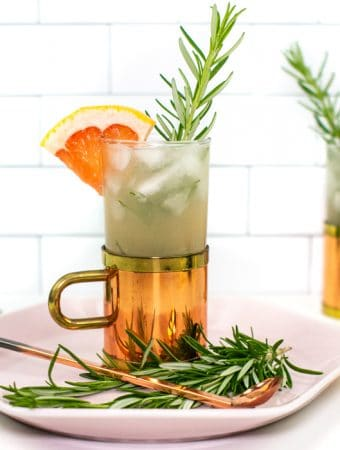 a grapefruit moscow mule in a glass and copper mug