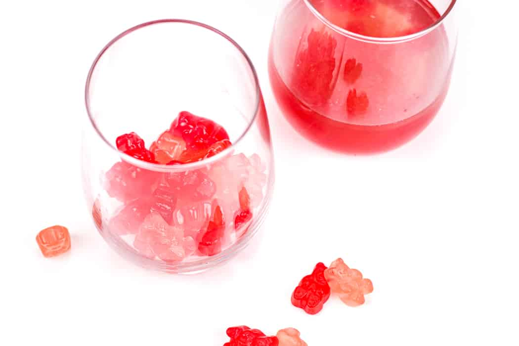 red and pink gummy bears with wine in a stemless wine glass