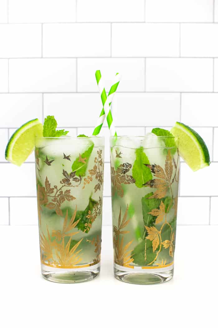 two classic mojitos with green and white striped straws