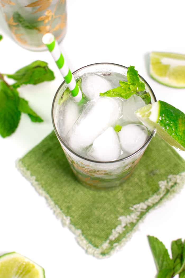 town down view of a classic mojito with mint leaves and lime wedges