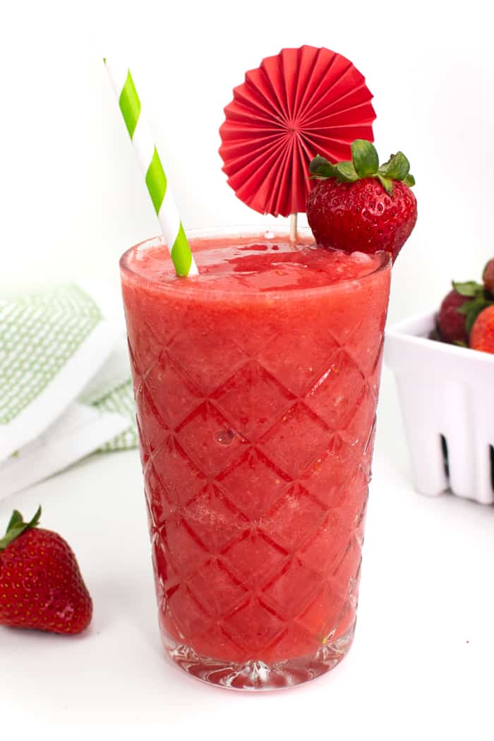 an ornate glass filled with a frozen strawberry daiquiri