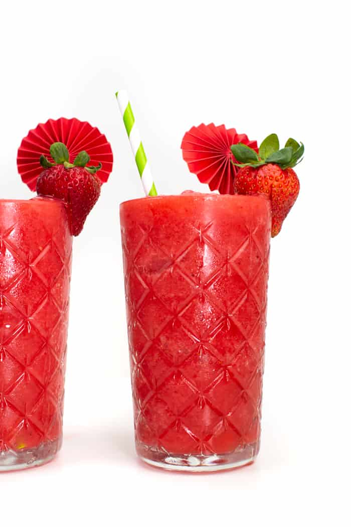 ornate glasses filled with strawberry cocktail