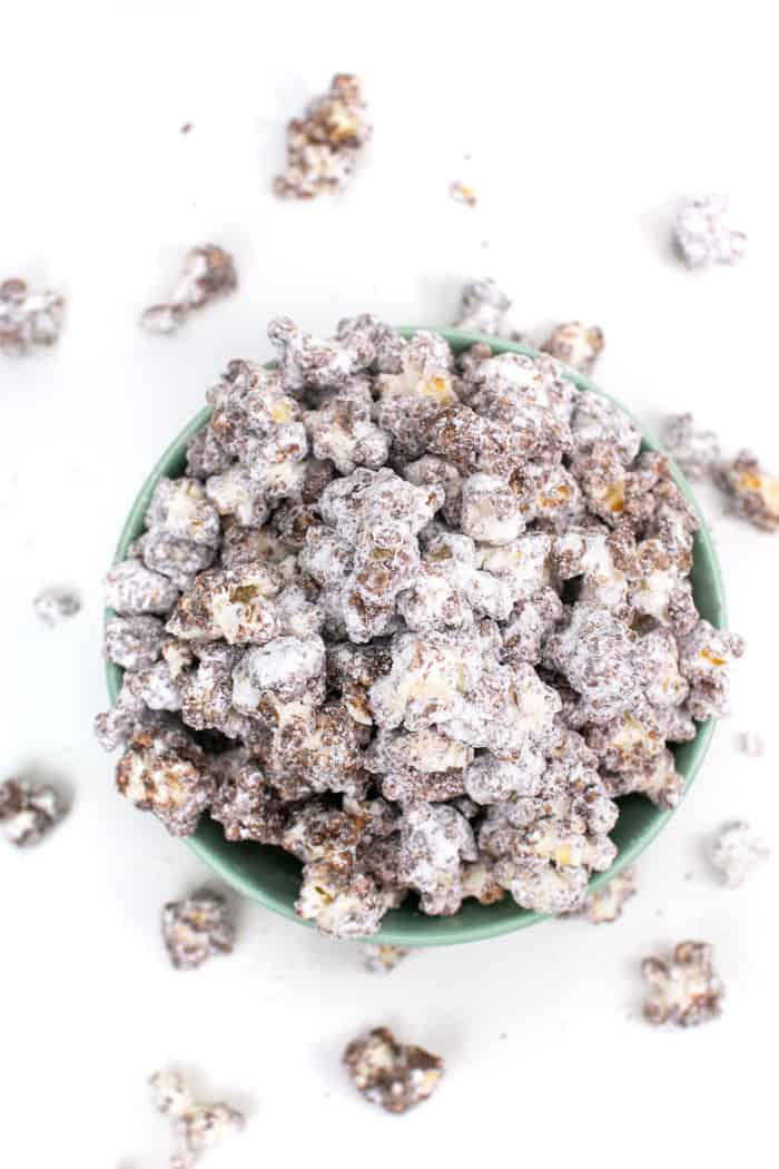 a top view of Puppy Chow Popcorn with kernels spilling over
