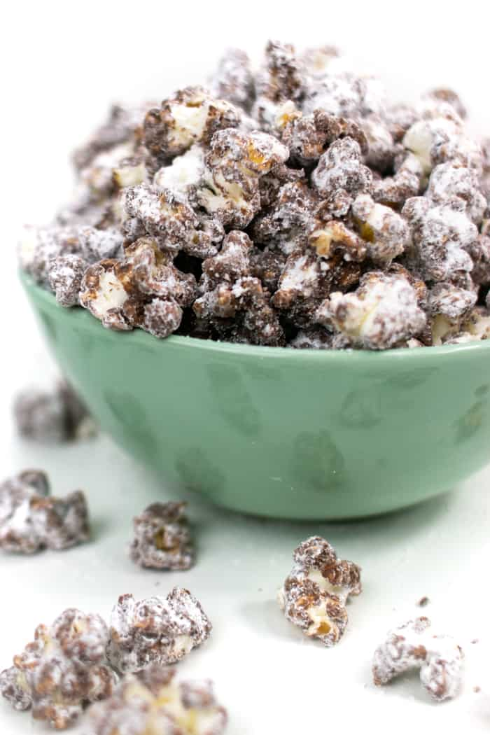a heaping bowl of puppy chow popcorn