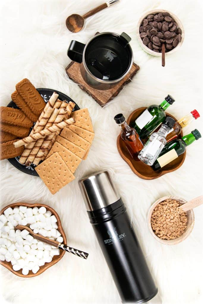 a stanley legendary bottle surrounded by hot chocolate party mixins and mini bottles