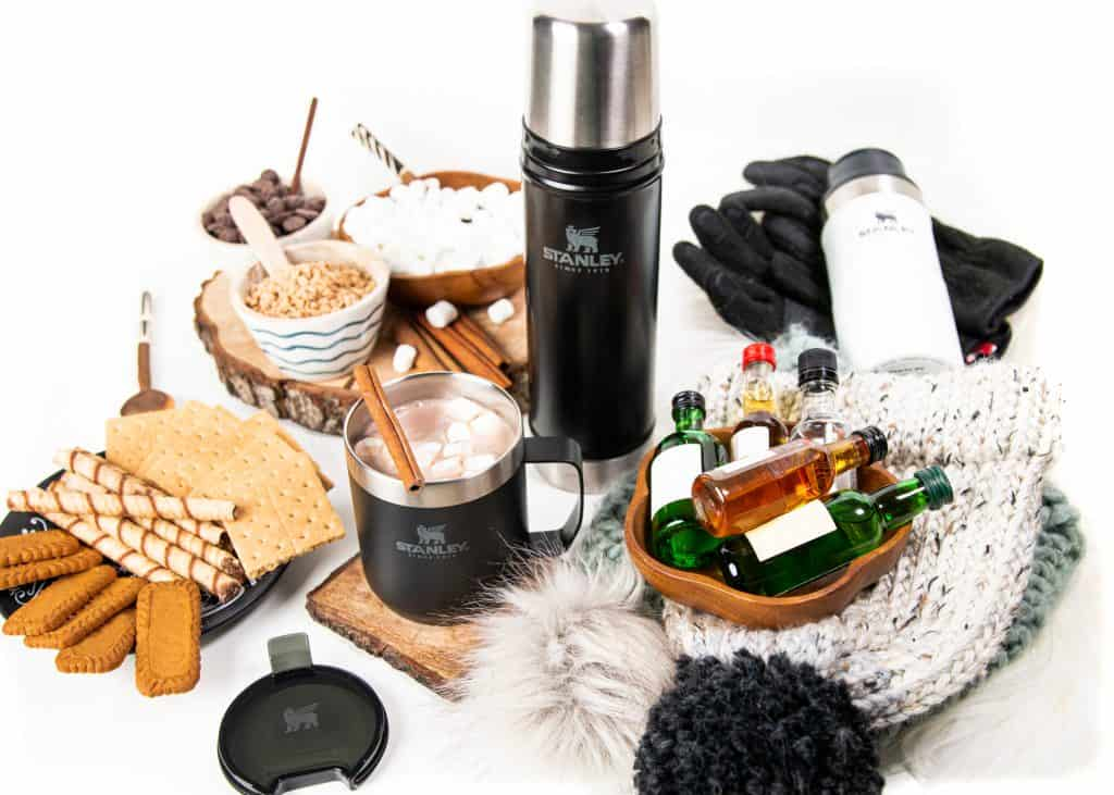 an array of supplies and stanley drinkware for a hot chocolate party