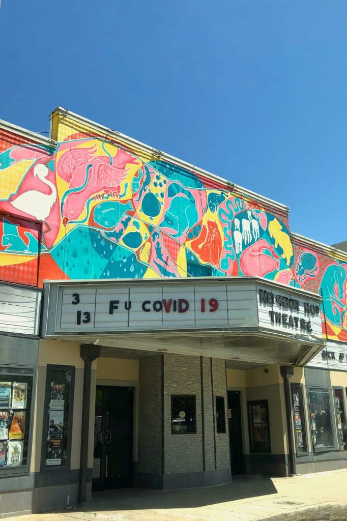 "a movie theatre sign that reads ""f u covid 19"""