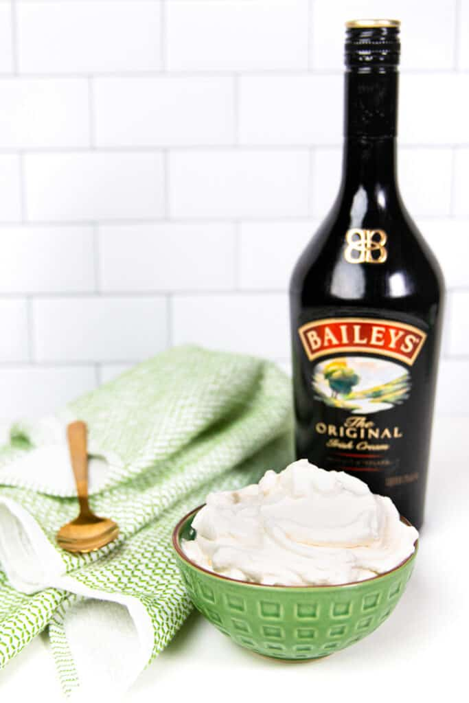 bailey's irish cream in a green bowl with a gold spoon