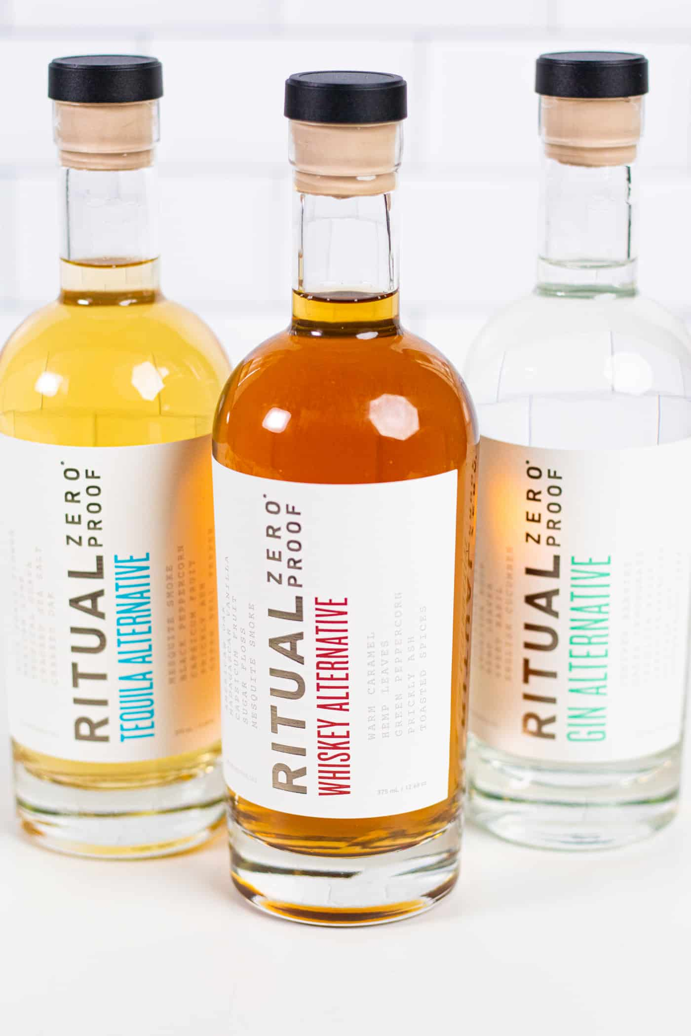 a trio of bottles of ritual zero proof alcohol