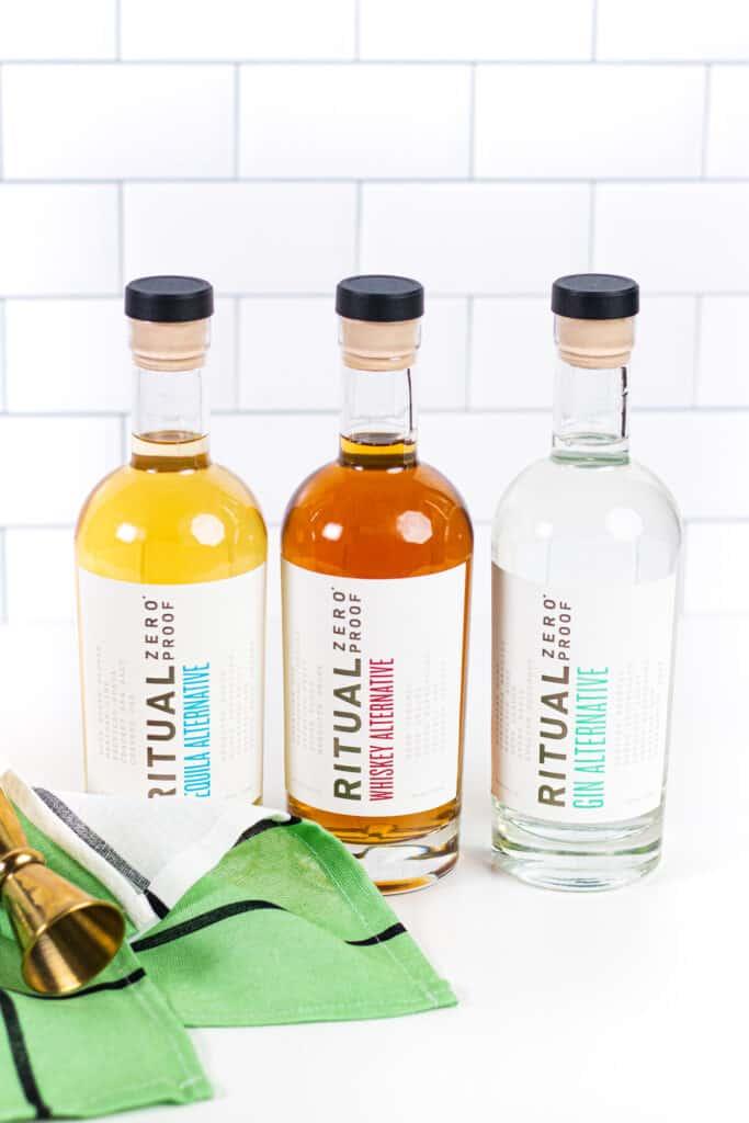 three bottles of ritual zero proof alcohol