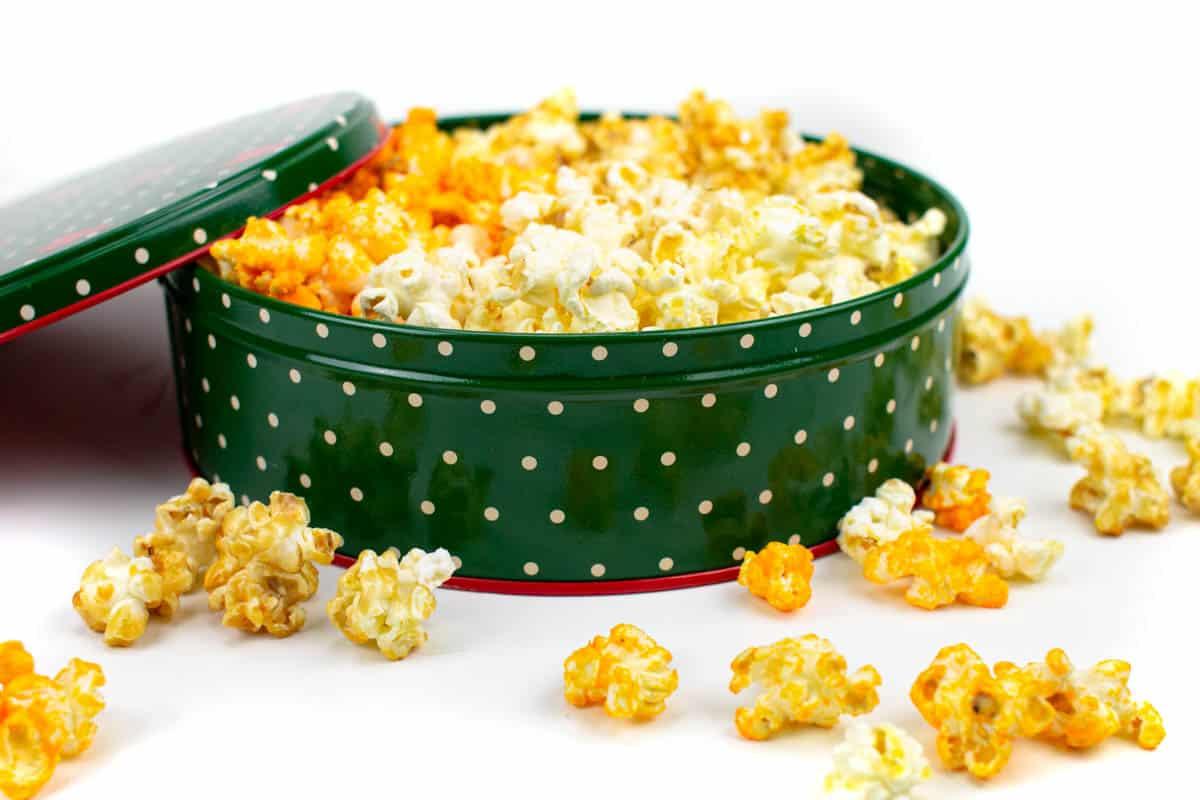 an open tin of christmas popcorn