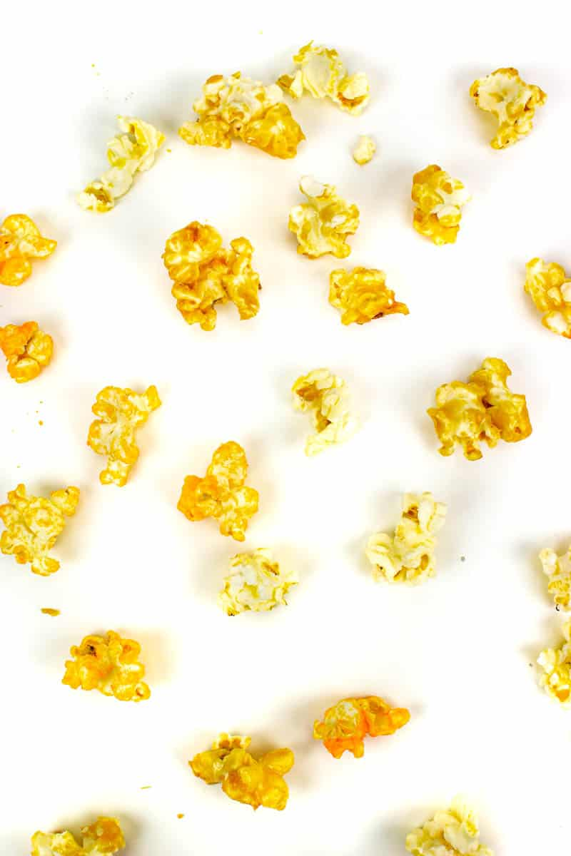 three kinds of popcorn kernels on a white background