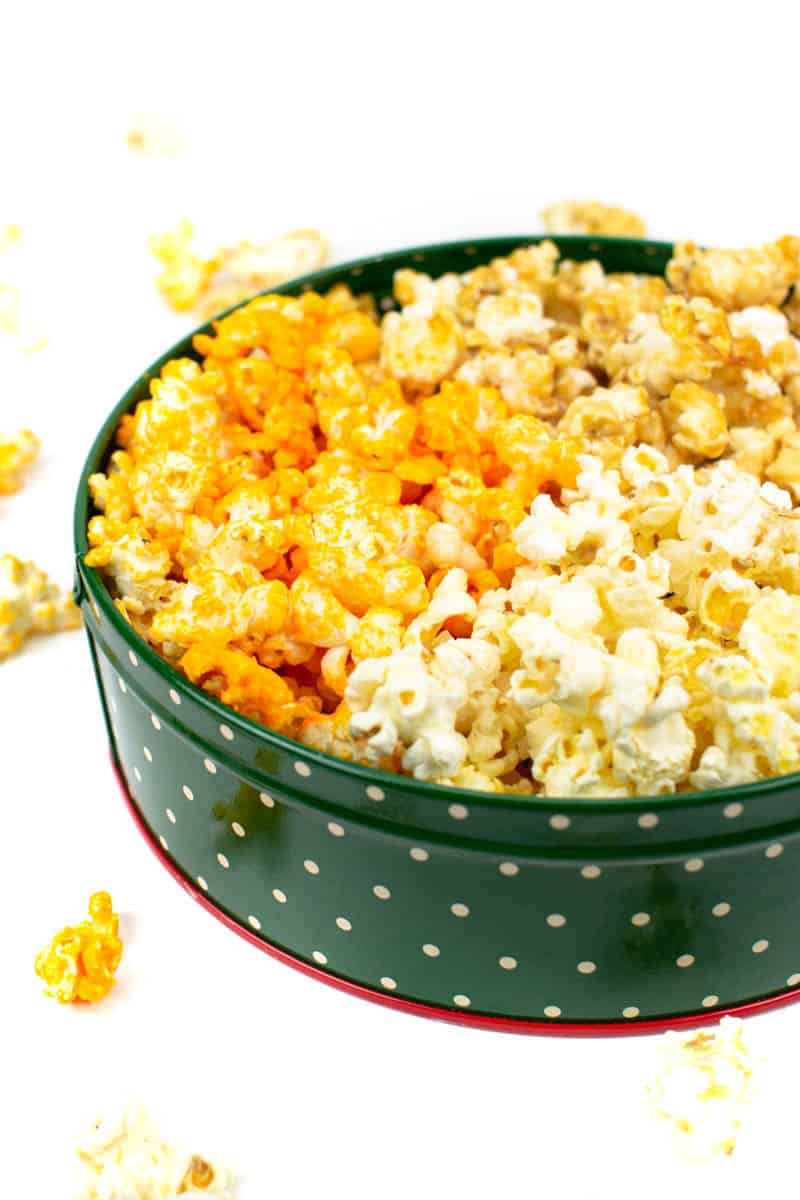 popcorn spilling out of christmas popcorn tin