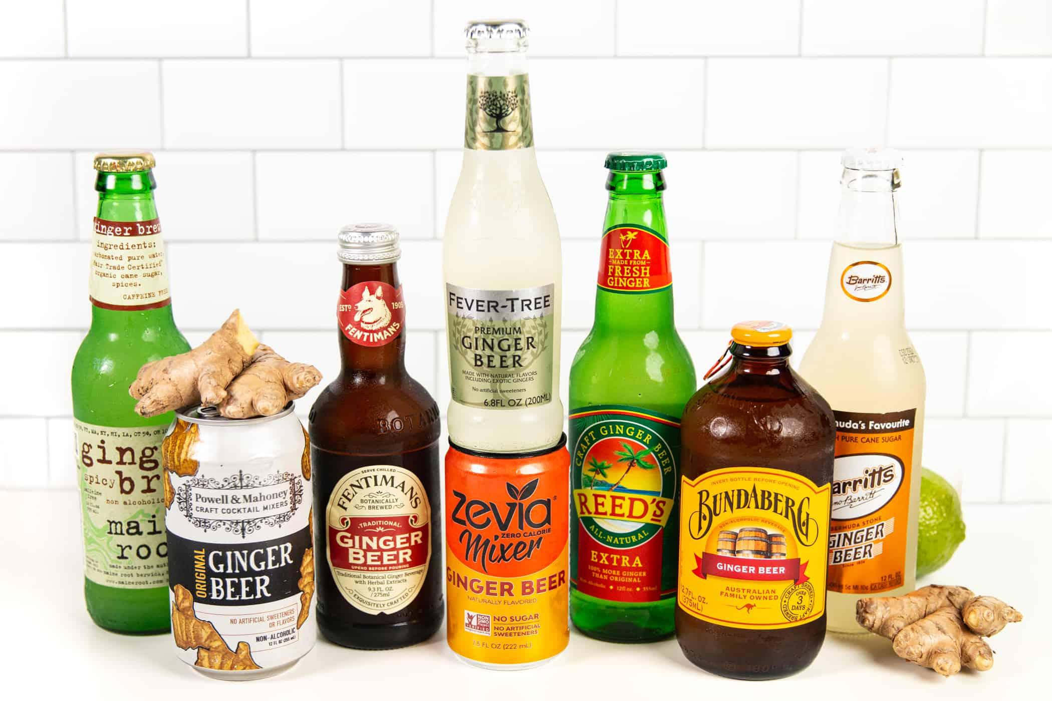 8 bottles of ginger beer on a white tile counter