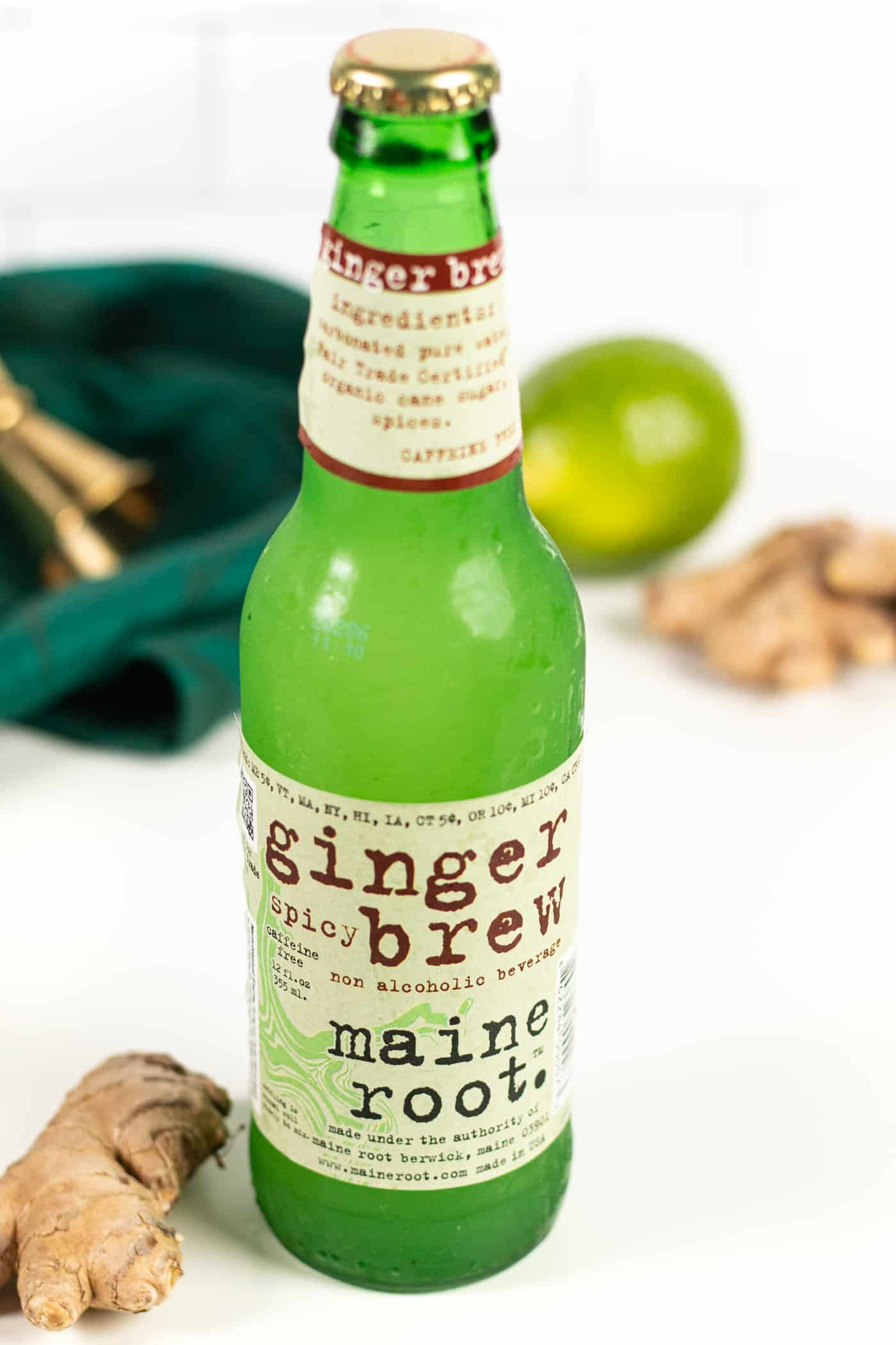 a bottle of maine root ginger brew beer on a white background