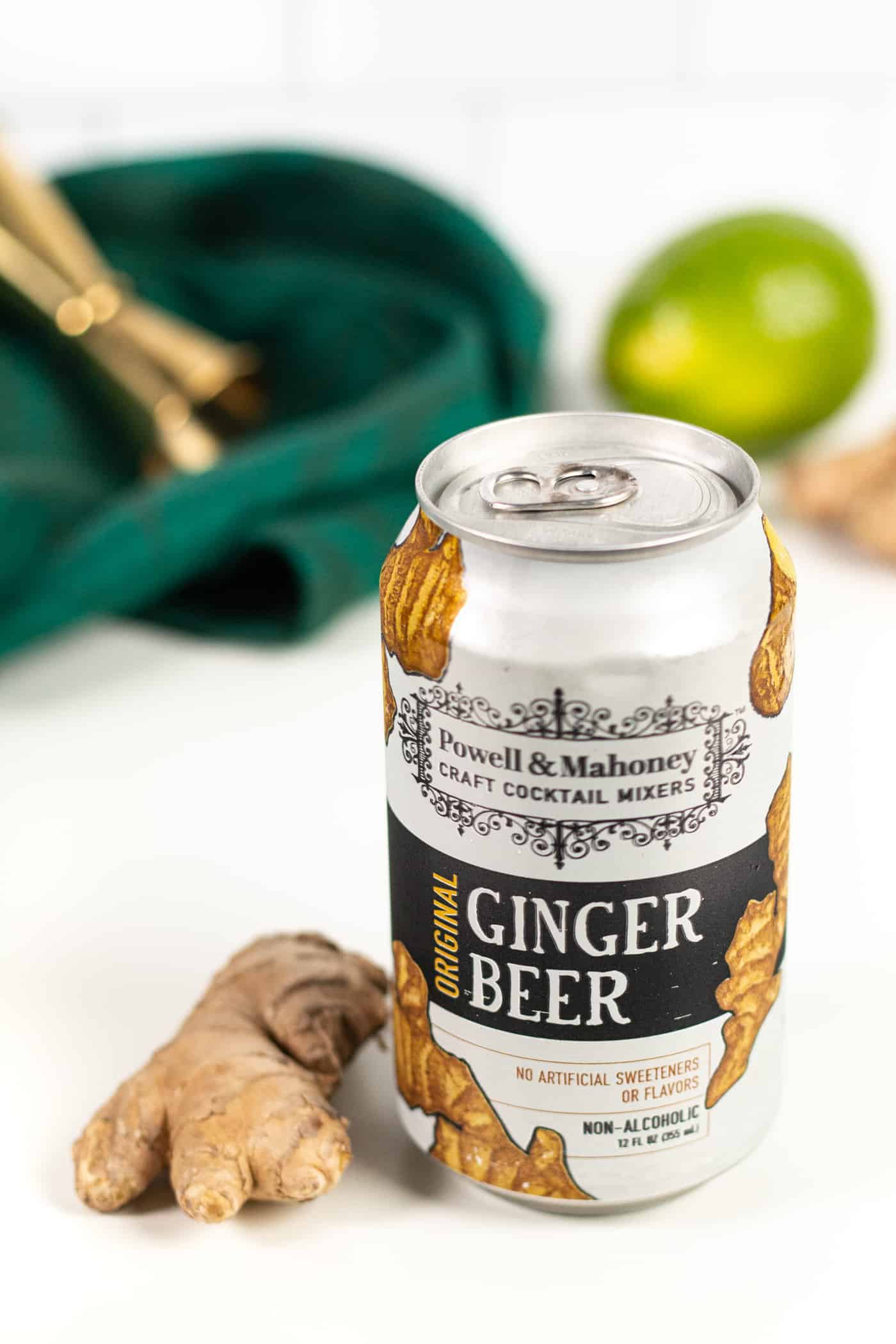 a powell & mahoney ginger beer can with a green tea towel