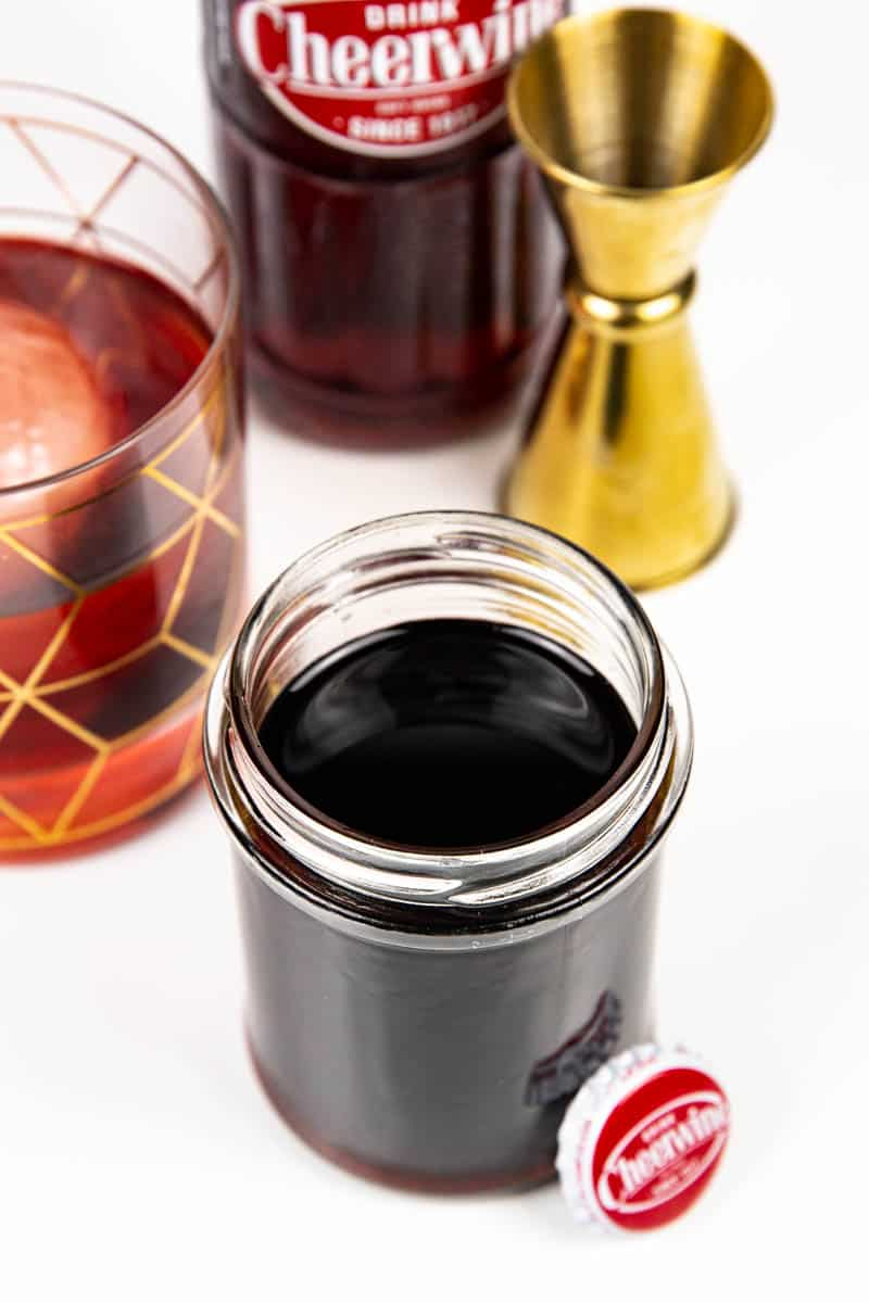 a jar of cheerwine syrup with a cheerwine bottle cap and a Cheerwine Old-Fashioned