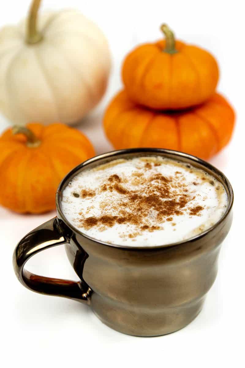 an homemade pumpkin spice latte in a brown metallic ceramic mug